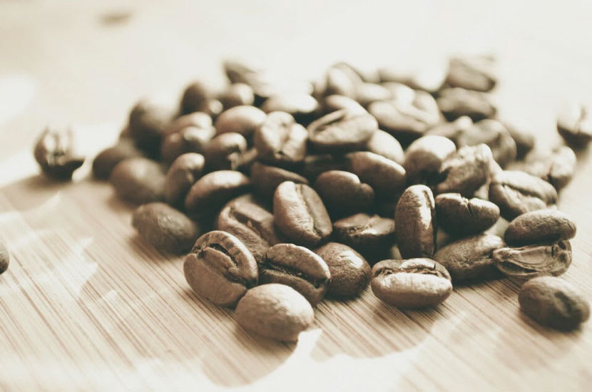 Coffee beans on brown table