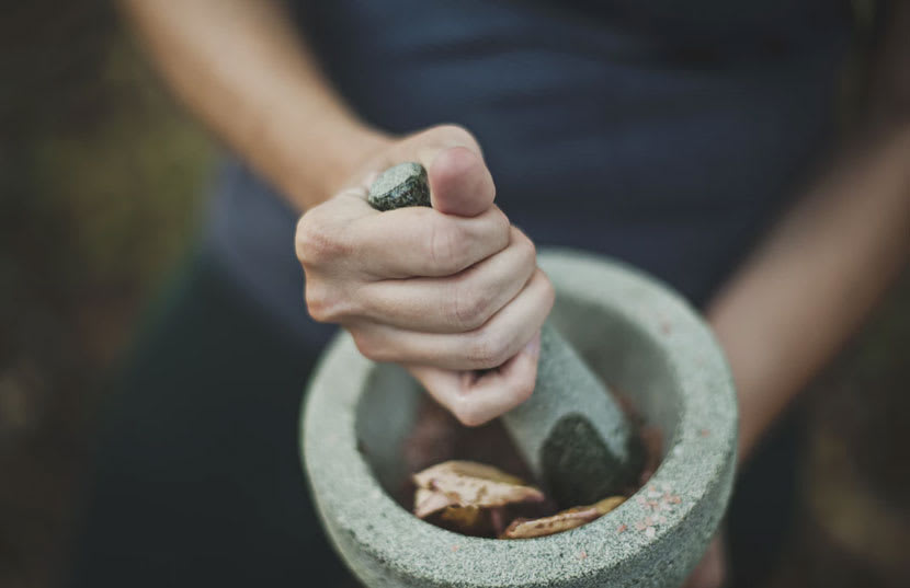 Person using mortar and pestle
