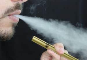 CBDfx vape pen. Man smoking CBDfx vape pen. CBD helping solve the vape crisis