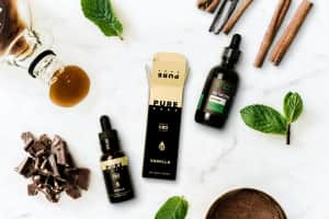 Some of the tastiest CBD flavors sit spread out on a white background