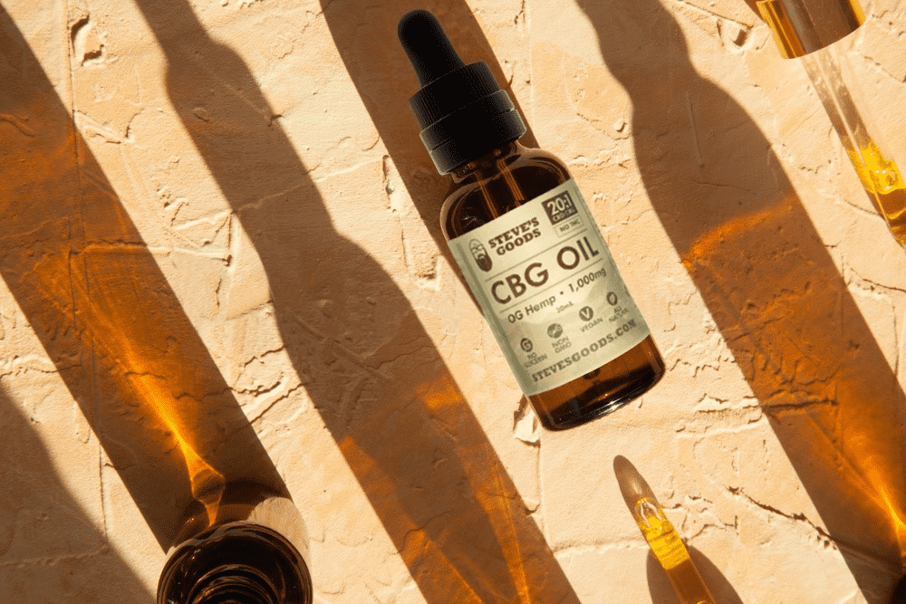 An array of wholesale CBD products sit on a wooden surface