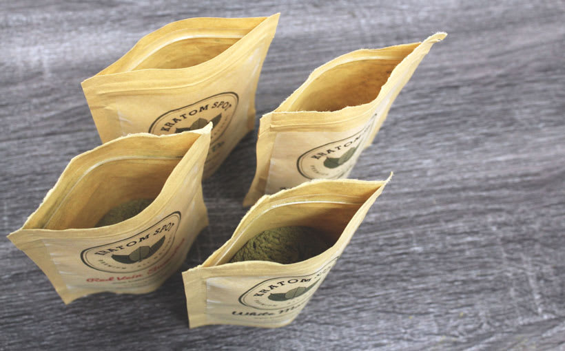 Four pouches filled with Kratom products