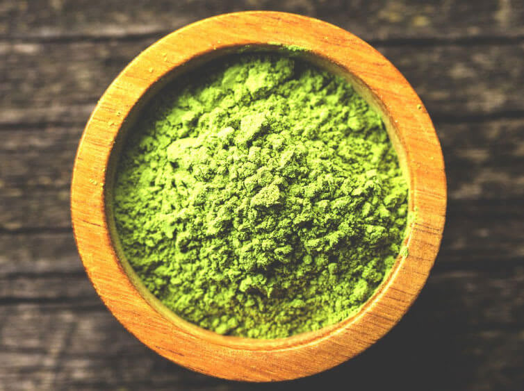 A bowl of green Kratom powder