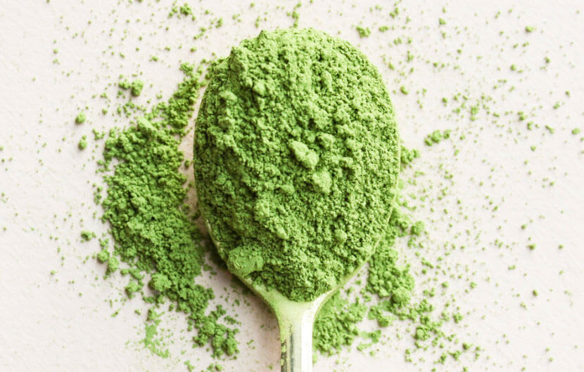 A spoon overflowing with Kratom powder