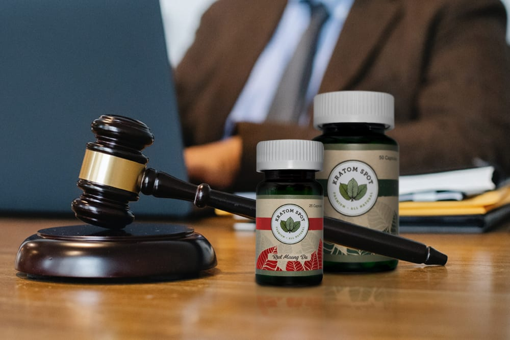 A gavel next to kratom products