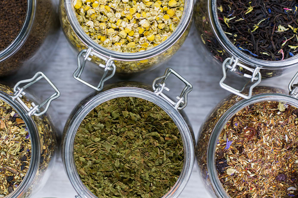 An array of herbal teas for personal wellness, including chamomile, ginger, and kratom teas.