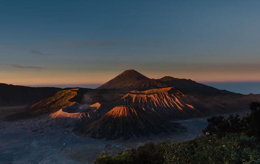 A volcanic mountain range at sunset