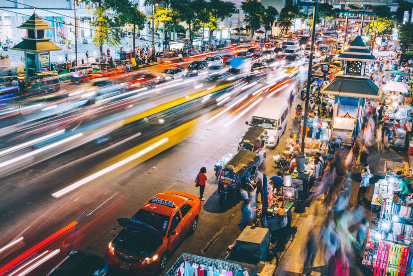 Cars rush down busy street in Thailand