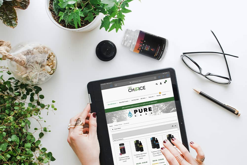 Someone shopping for CBD on their iPad, wondering why is CBD so expensive?
