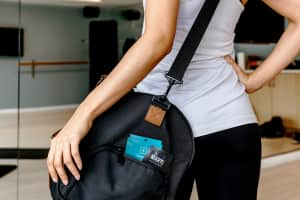 A woman carrying a duffel bag full of CBD patches