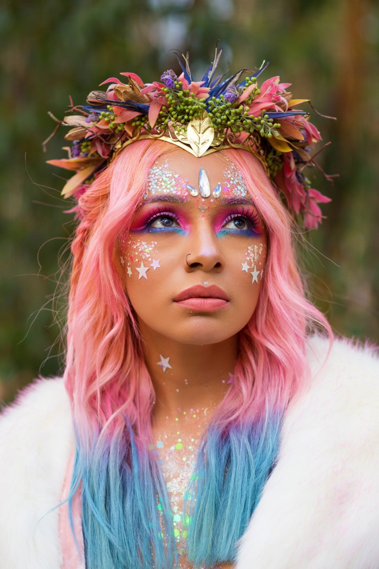 Pink hair glitter girl wearing our faux fur fluffy goddess jacket and a woodland floral crown.