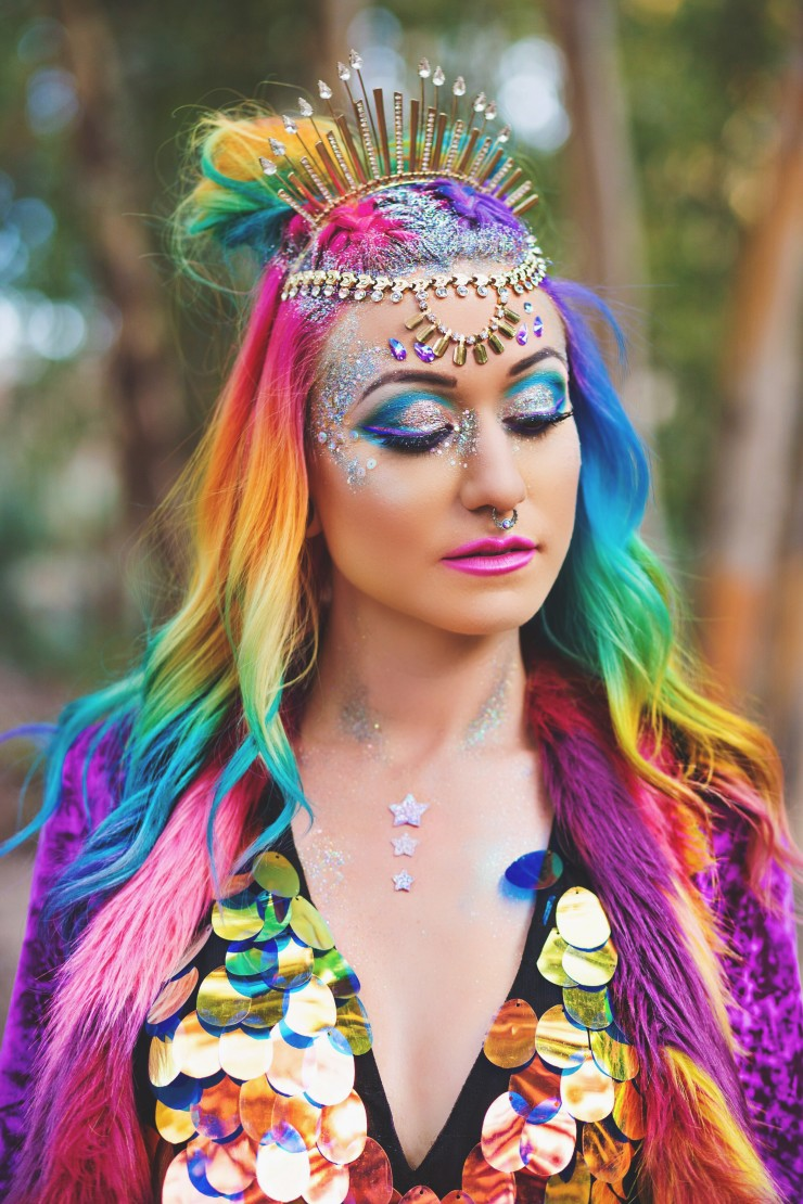 Rainbow haired girl wearing a rainbow sequin dress and amethyst shag jacket.