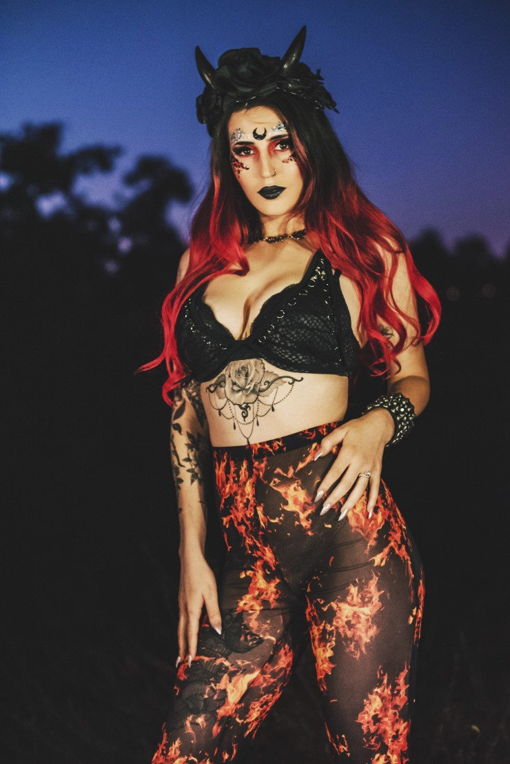 Red haired devil girl in flame pants.