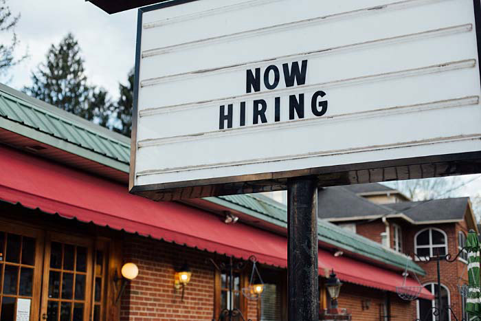 """Marquee sign """"Now Hiring"""""""