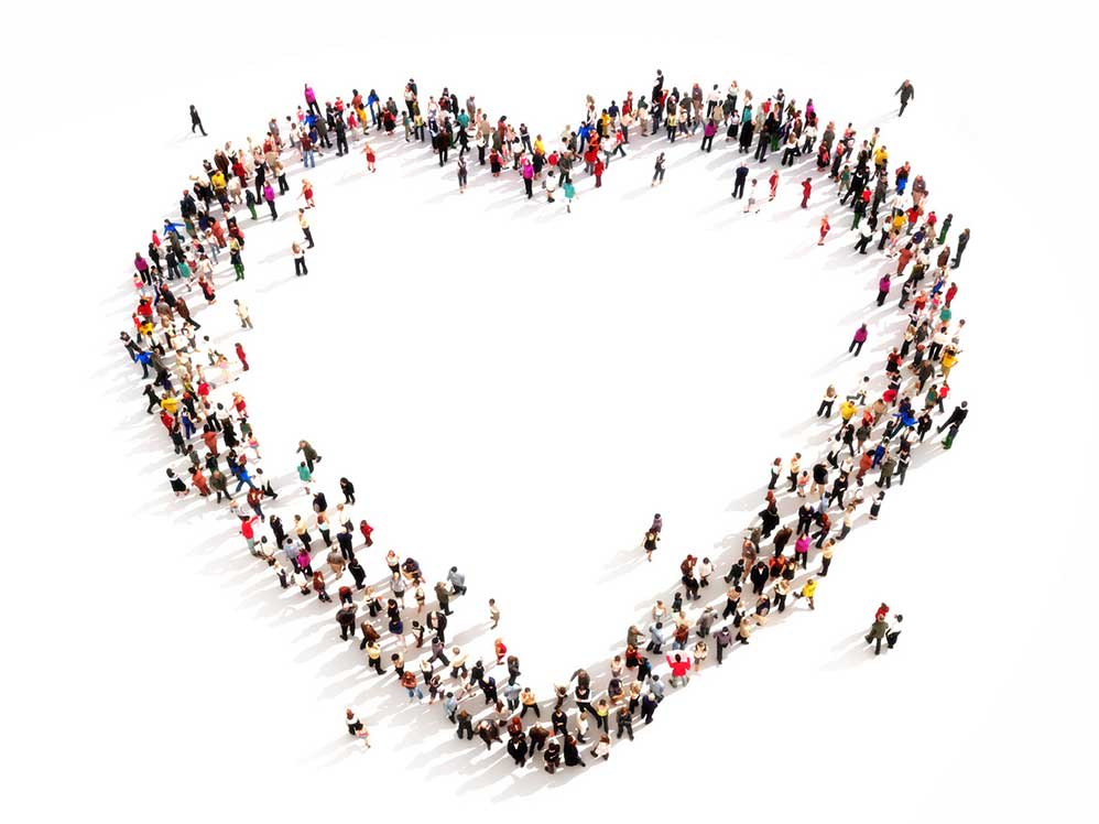 group of people in the shape of heart