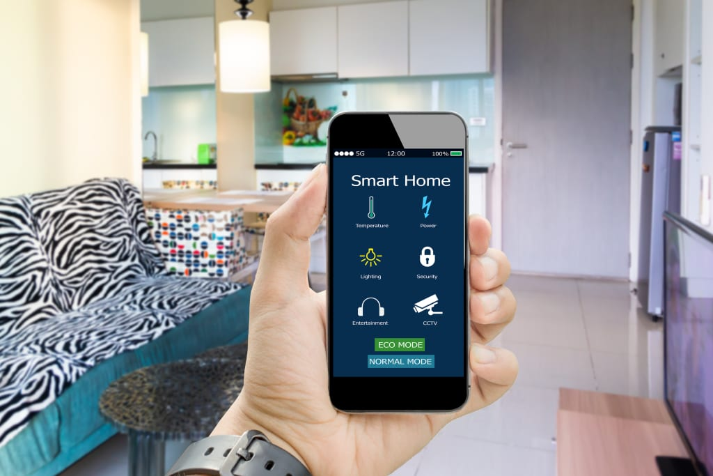 Person holding smartphone with the smart home automation app open