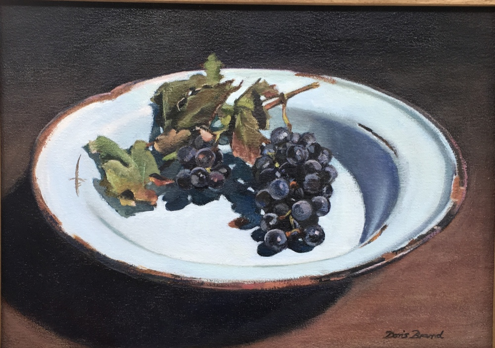 Wine grapes on old enamel plate