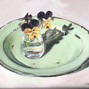 Violas in old enamel plate