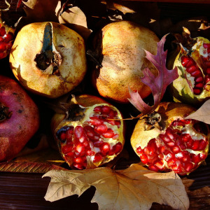 Pomegranate and autumn leaves