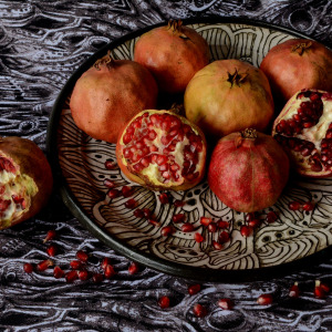 Pomegranates and plate