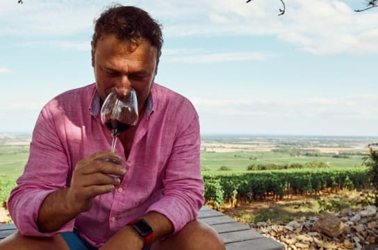 A winemaker drinks tannic red wine