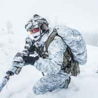 Winter arctic mountains warfare. Action in cold conditions. Pair of special forces weapons in forest somewhere above the Arctic Circle