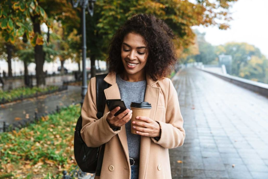 girl smiling with phone
