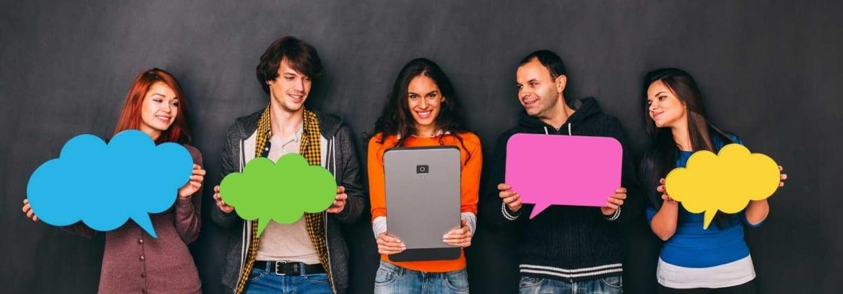 people holding up social media symbols
