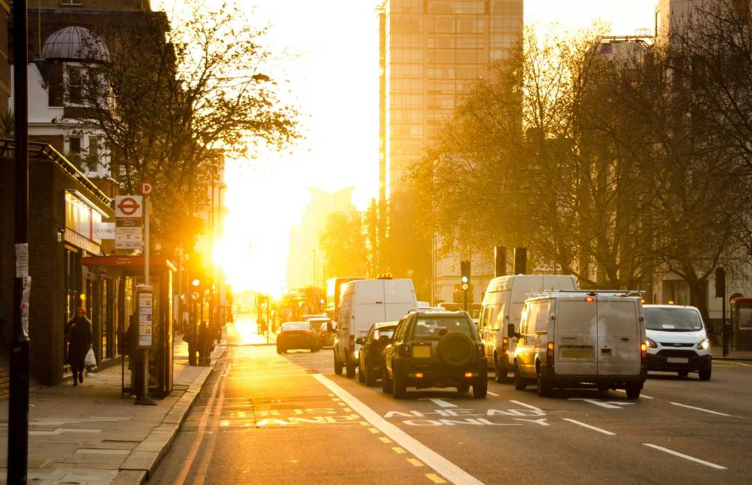 cars and vans driving in the morning in london