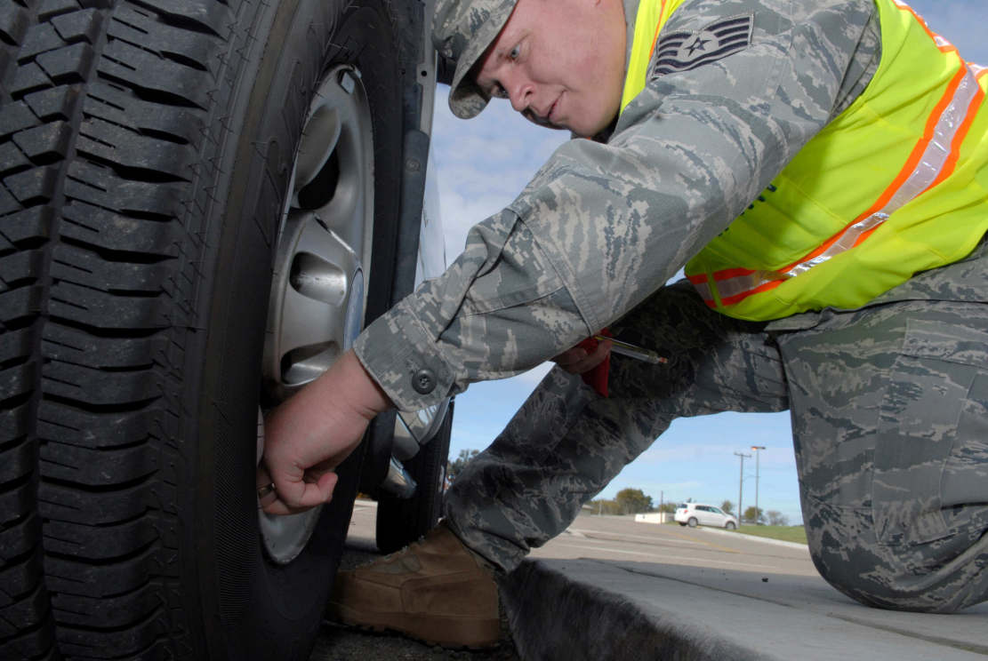 Military man changing a tyre