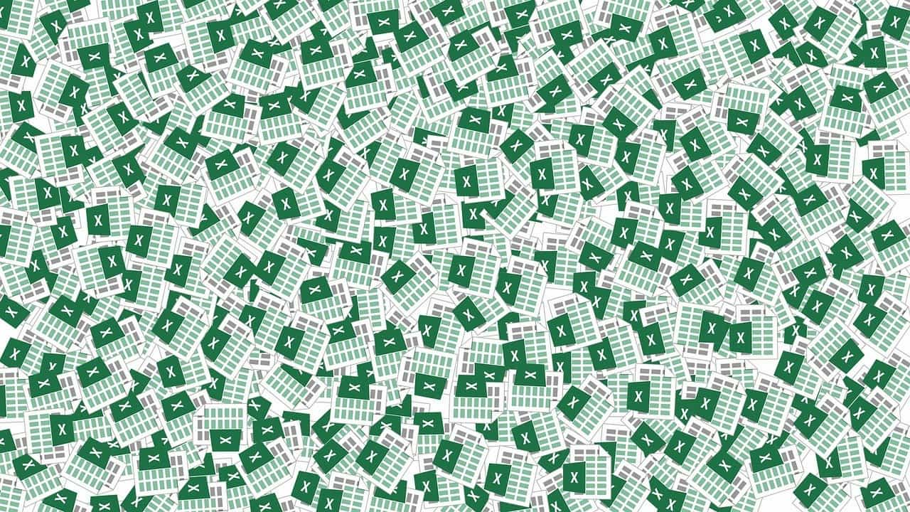 A pile of excel spreadsheet logos demonstrates the mess of cash flow issues you get if you don't use accounting software