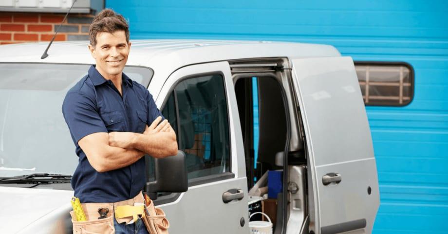 Workman standing in front of his van