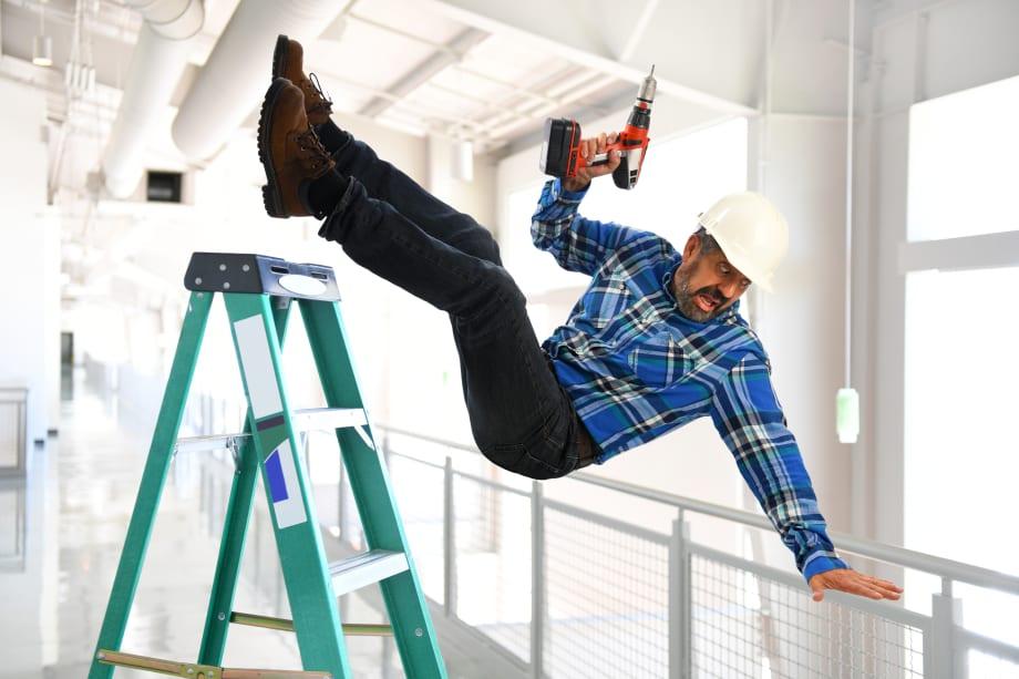 Workman falling off ladder