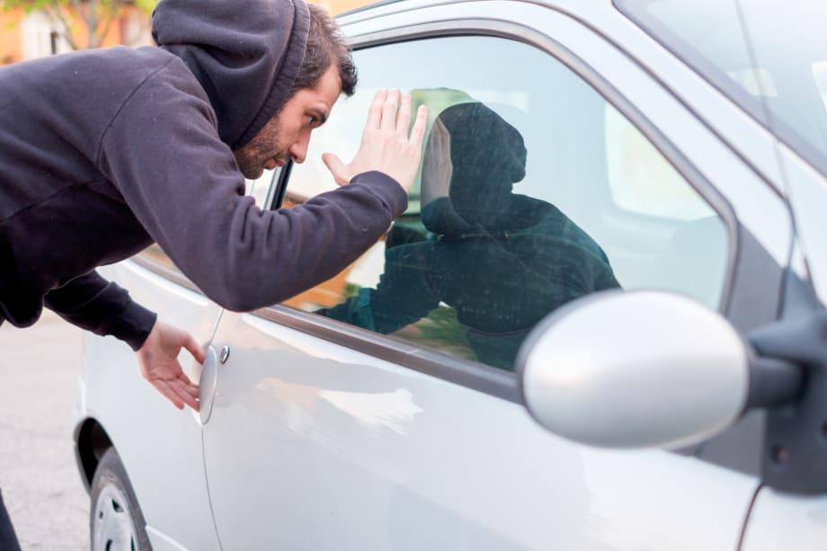 Thief looking into car