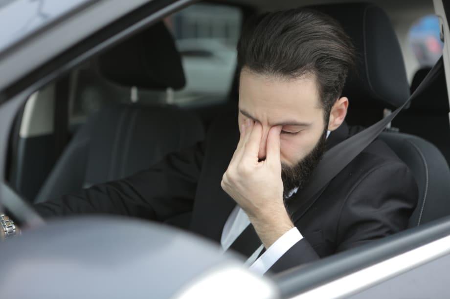 distressed man in car