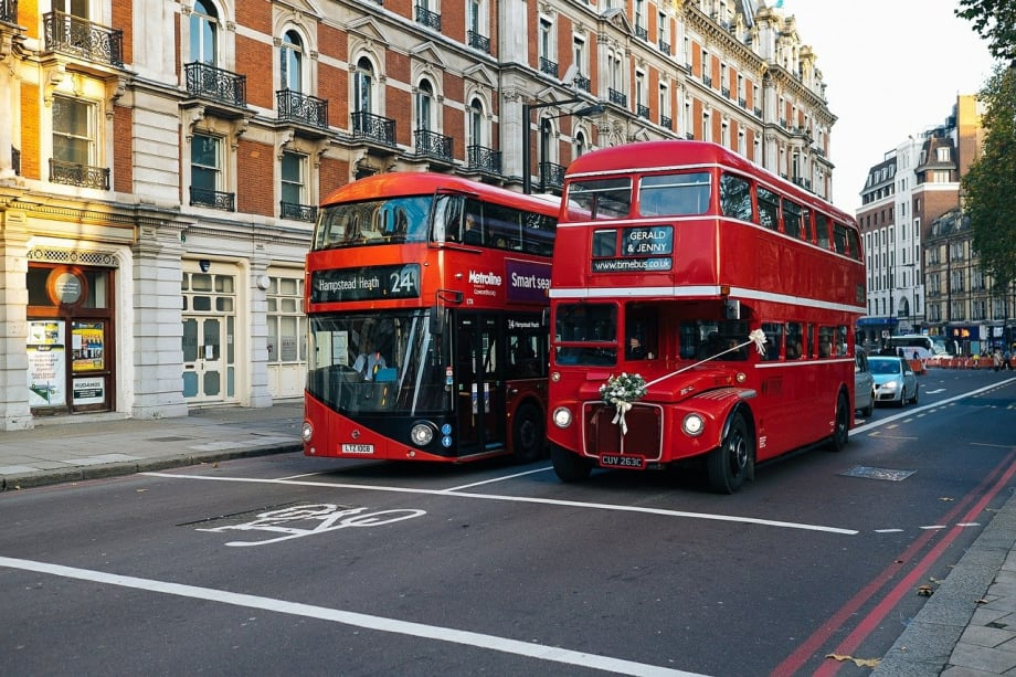 Two buses driving through London