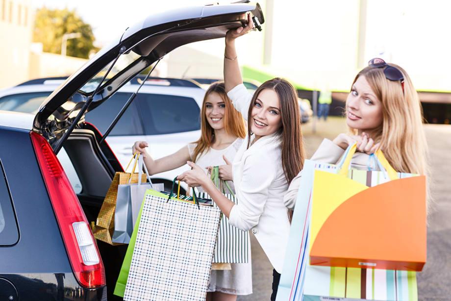 Women putting bags into car