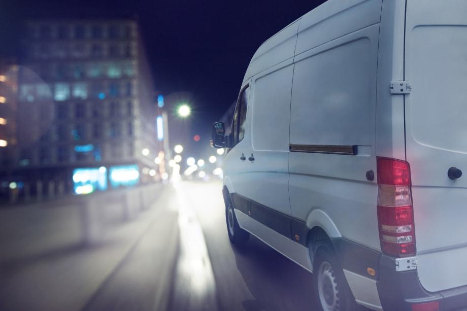 Van driving through the city