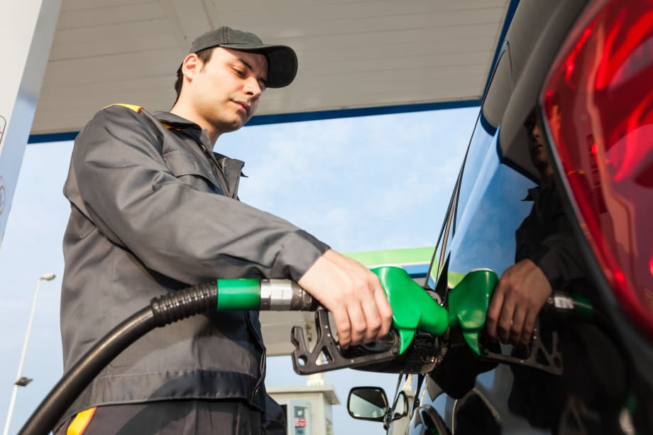 Man filling up vehicle with petrol