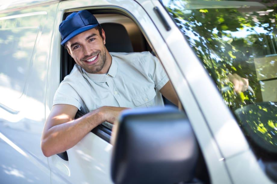Man leaning out van window