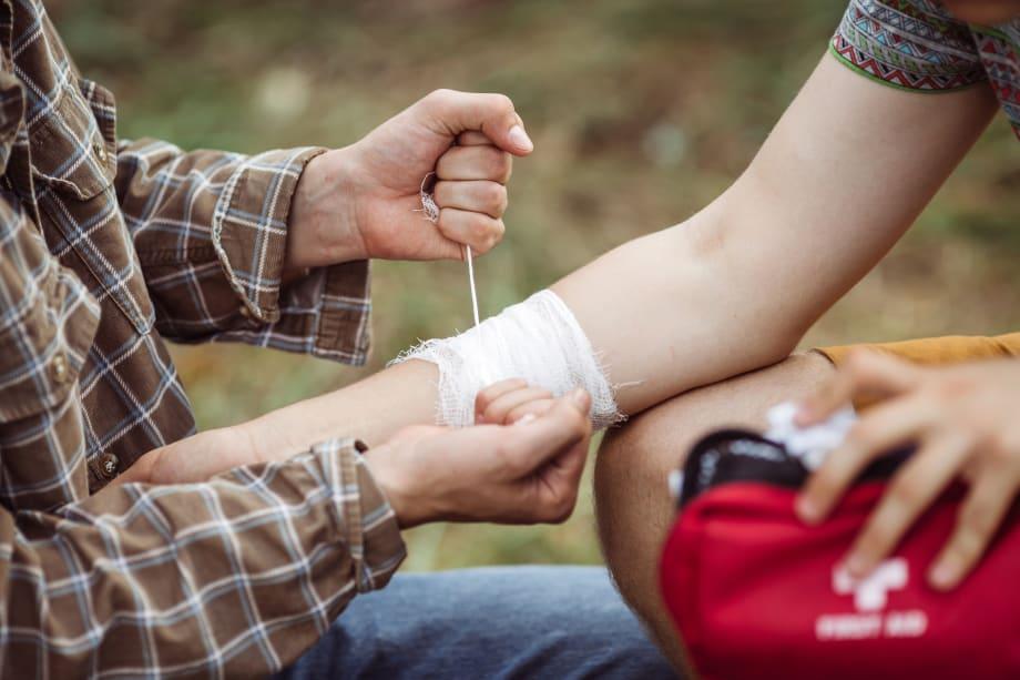 Man applying bandage