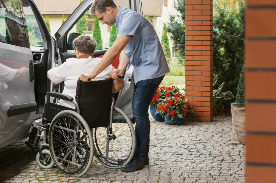 Care worker helping