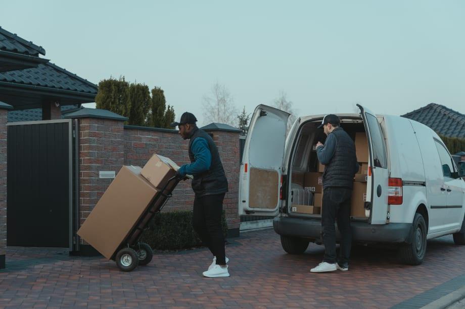 Couriers delivering parcels