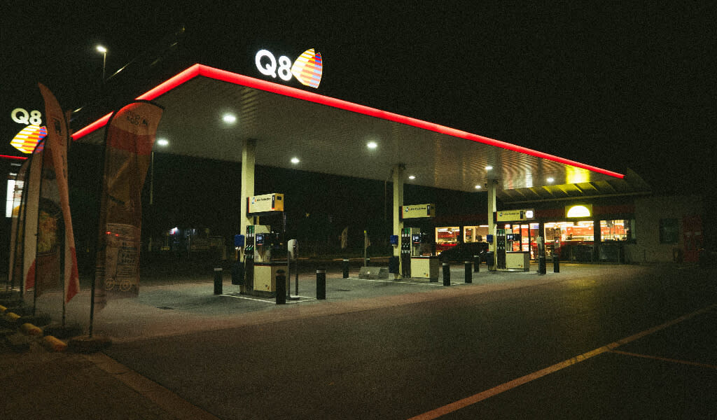 A Q8 fuel station at night