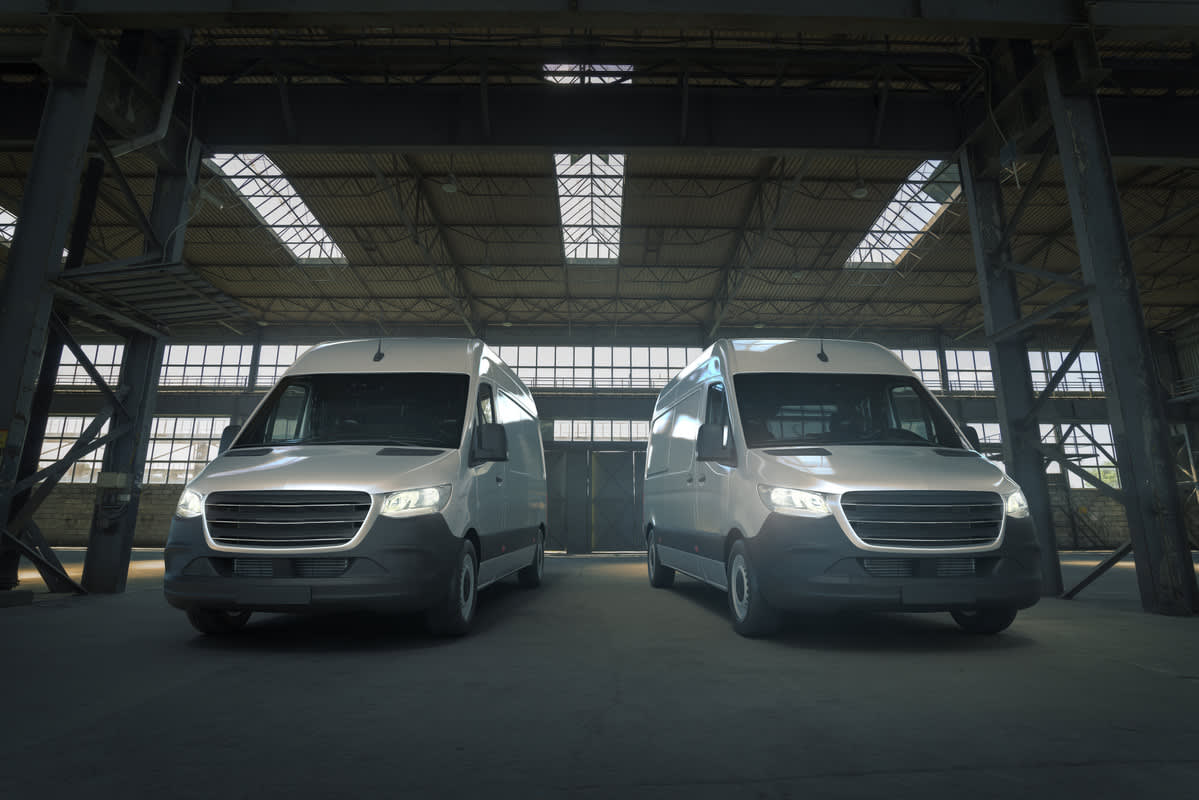 Two vans parked in a warehouse