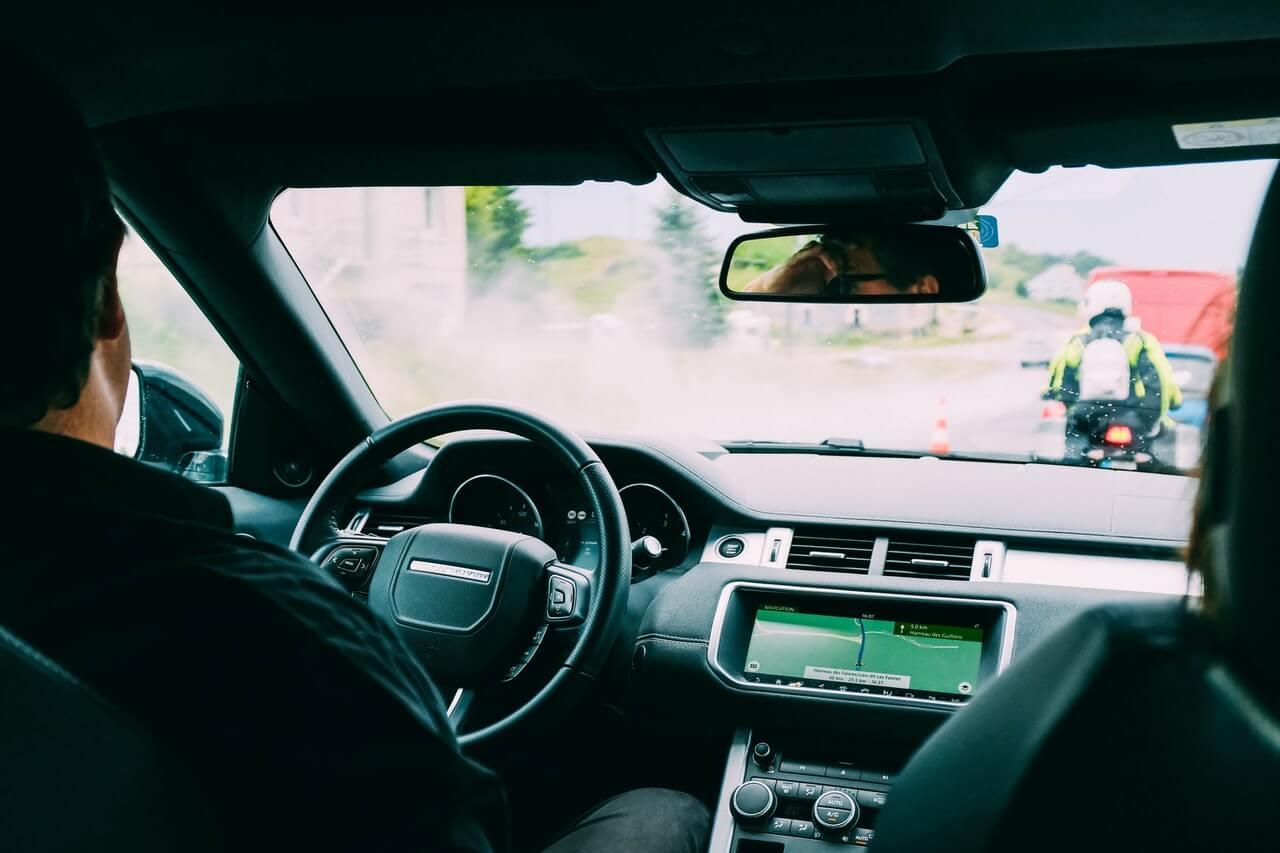 Man driving a car using sat nav