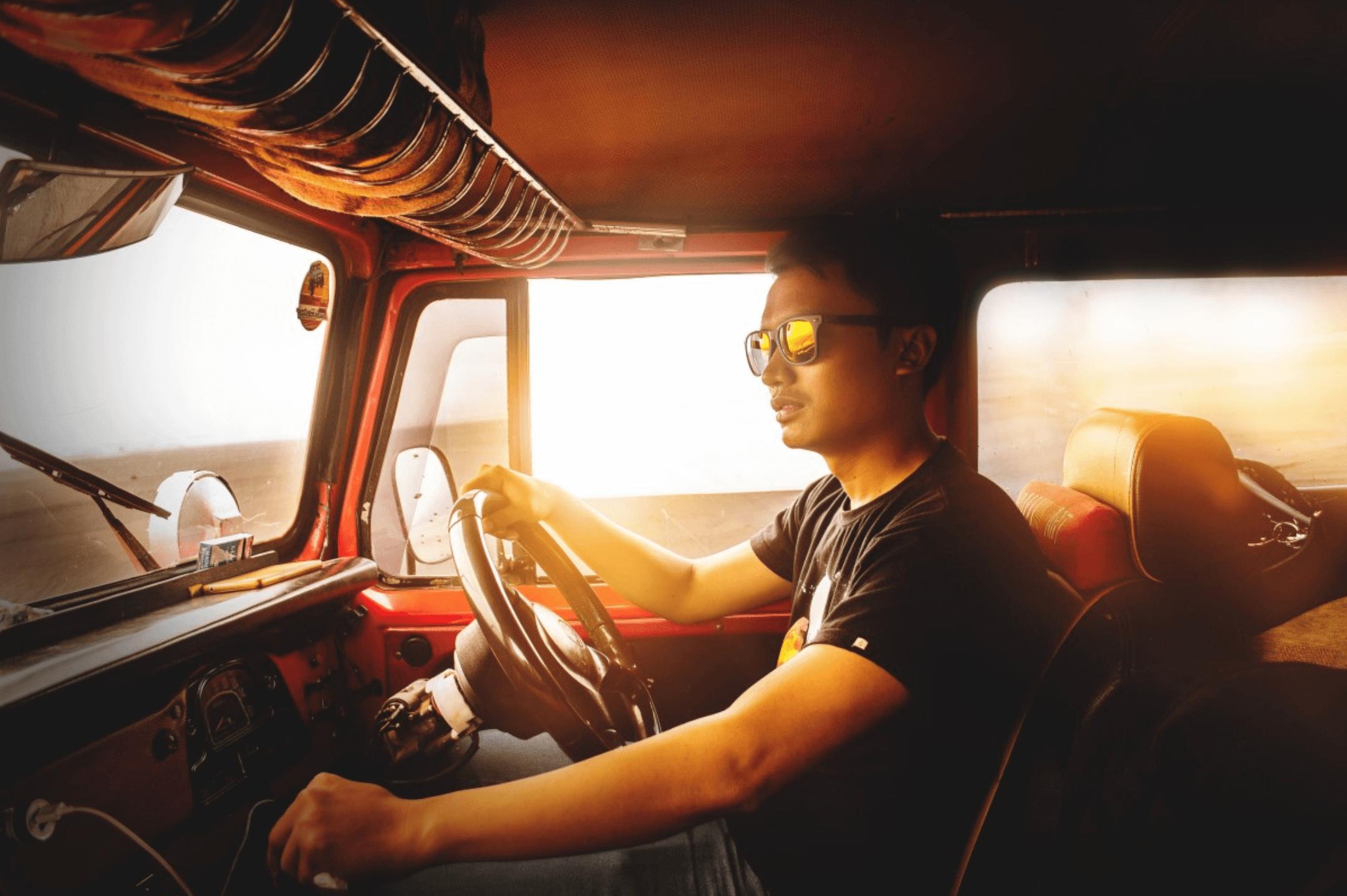 Man driving an old van
