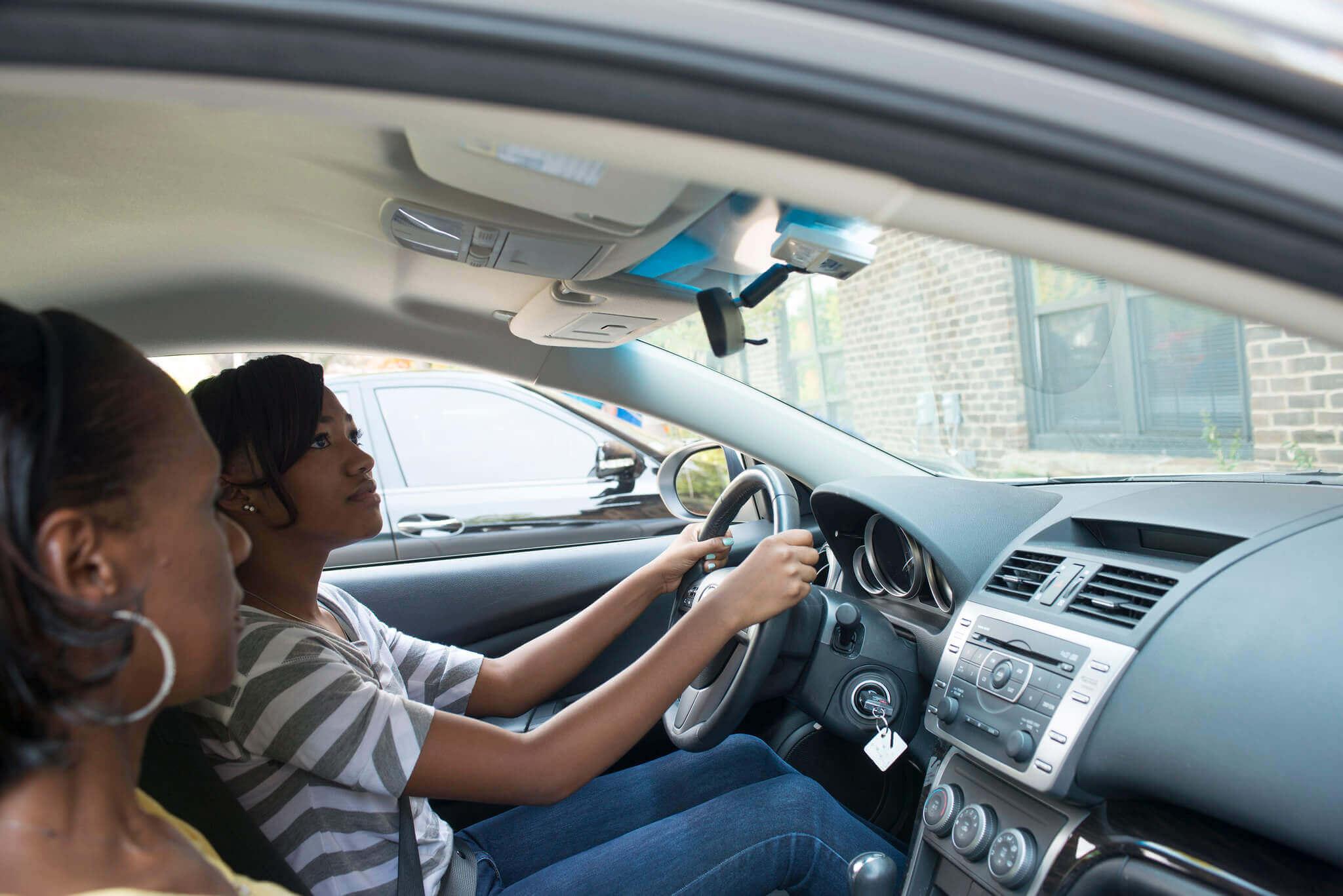 Two women sitting in a car