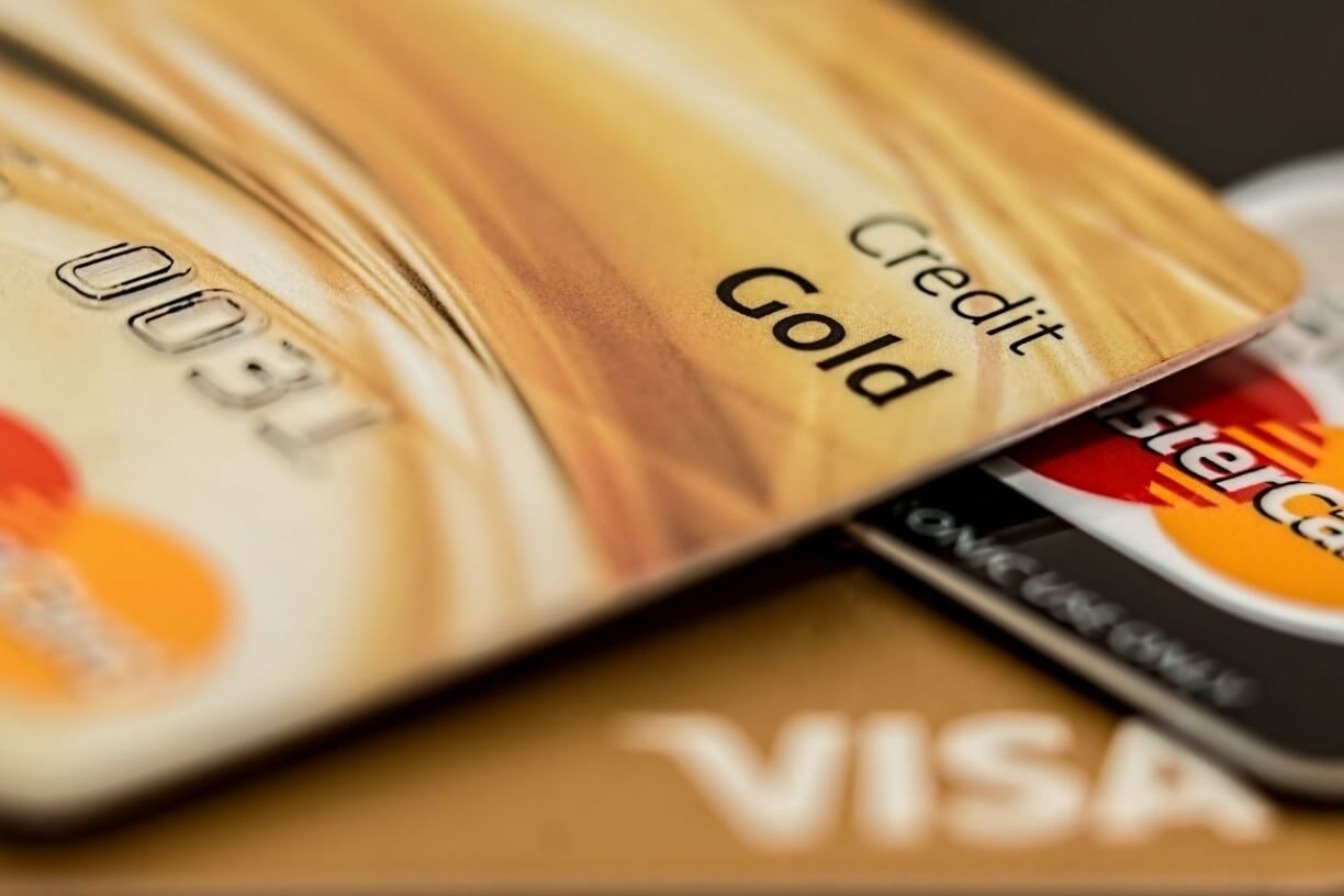 A close up of a Gold credit card