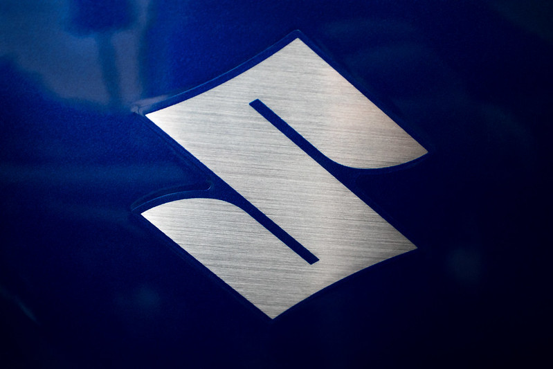 A Suzuki logo for one of the cheapest car options by fuel economy